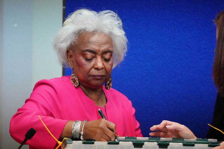 Broward County Supervisor of Elections Brenda Snipes signs a box during a ballot recount in Lauderhill, Florida, November 12.