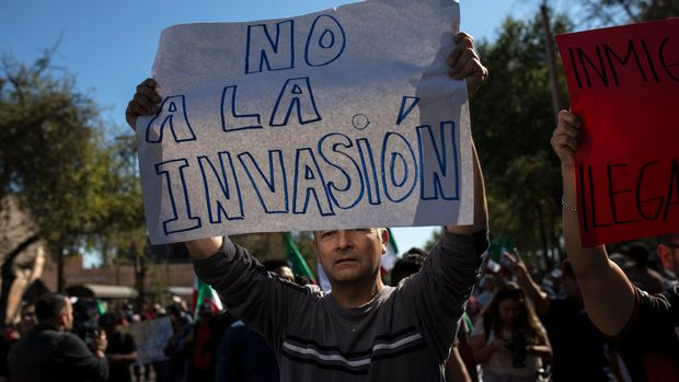 "A demonstrator with a sign that reads in Spanish: ""No to the invasion"" protests the presence of thousands of Central American migrants in Tijuana, Mexico, Sunday, Nov. 18, 2018. Protesters accused the migrants of being messy, ungrateful and a danger to Tijuana; complained about how the caravan forced its way into Mexico, calling it an ""invasion,"" and voiced worries that their taxes might be spent to care for the group as they wait possibly months to apply for U.S. asylum. (AP Photo/Rodrigo Abd)"