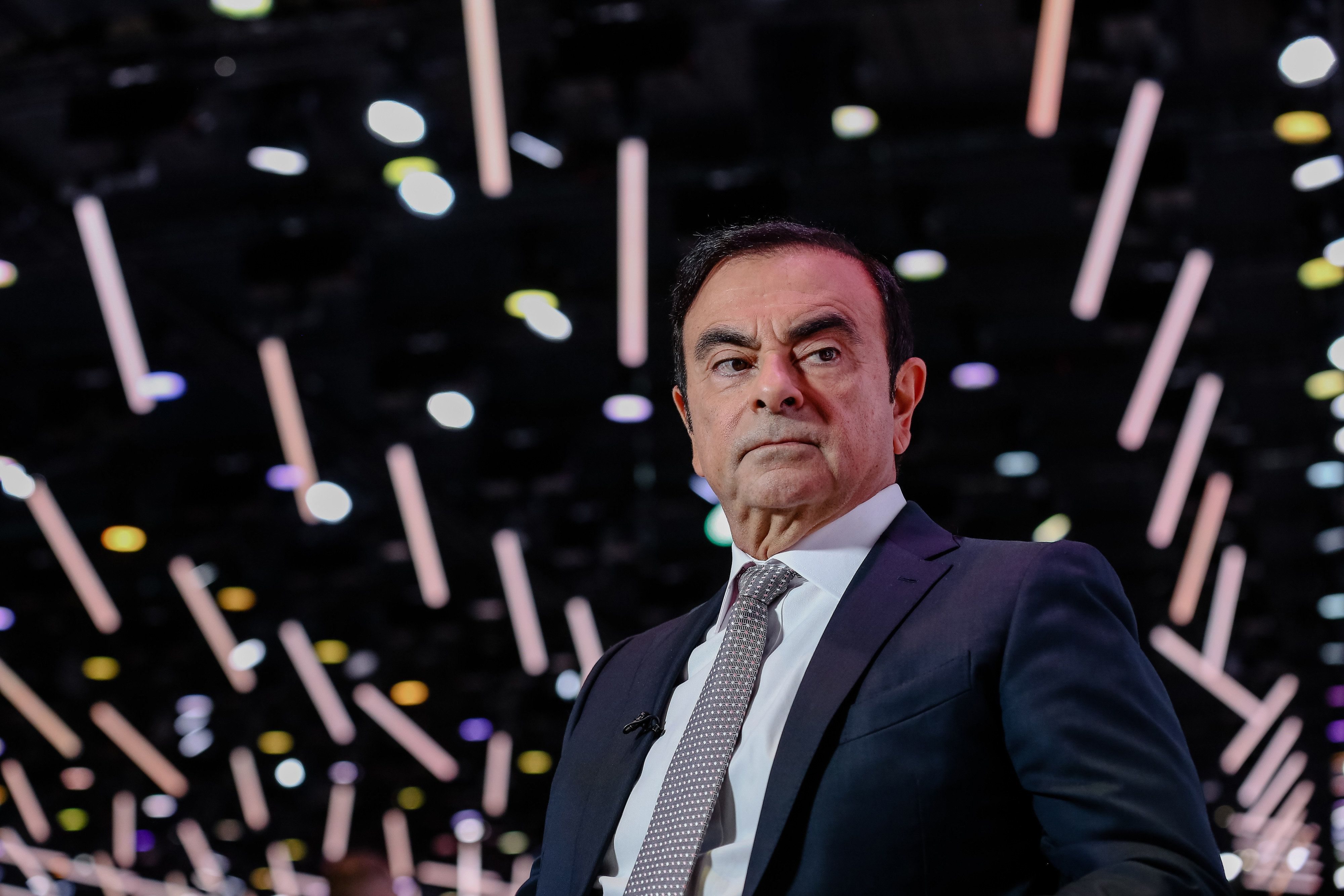 FILE: Carlos Ghosn, chairman of the alliance between Renault SA, Nissan Motor Co. and Mitsubishi Motors Corp., pauses during a Bloomberg Television interview at the Paris Motor Show in Paris, France, on Tuesday, Oct. 2, 2018. Ghosn, the chairman of Nissan Motor Co., is set to be arrested in Tokyo over a suspected breach of Japanese financial trading law, the Asahi newspaper reported. Photographer: Marlene Awaad/Bloomberg via Getty Images