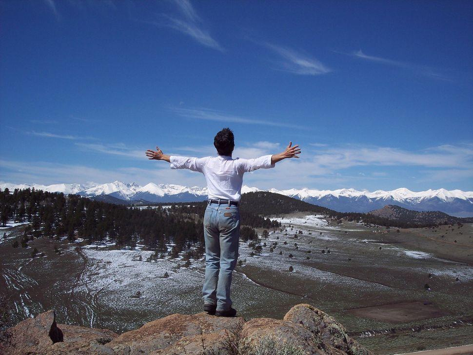 Phyllis embracing the Sangre de Cristo Mountains in 2005.