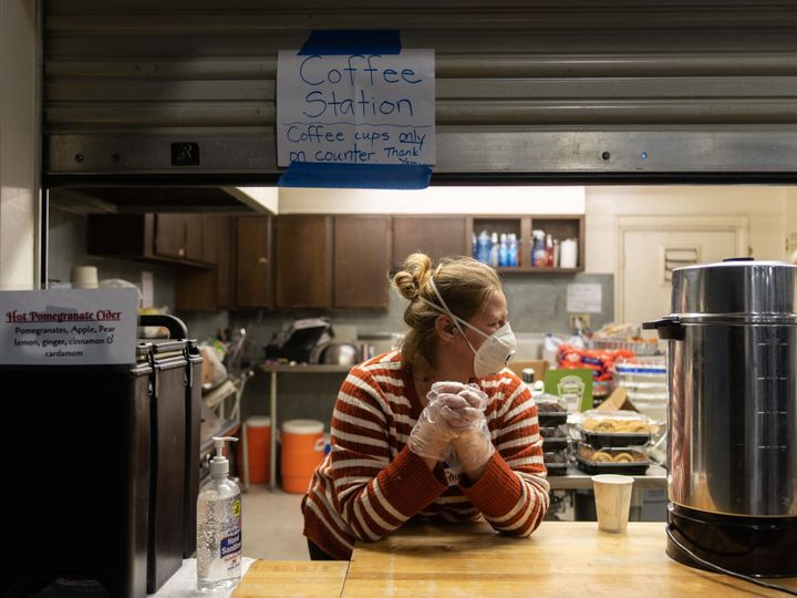Paula Levitt volunteers at a drink station at the East Avenue Church shelter.