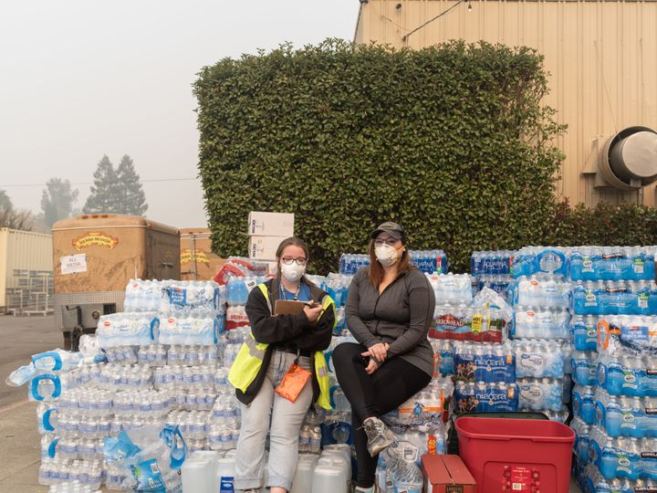 Kelsey Zimmer and Natalie Canida volunteer and coordinate relief efforts at the East Ave Church shelter.