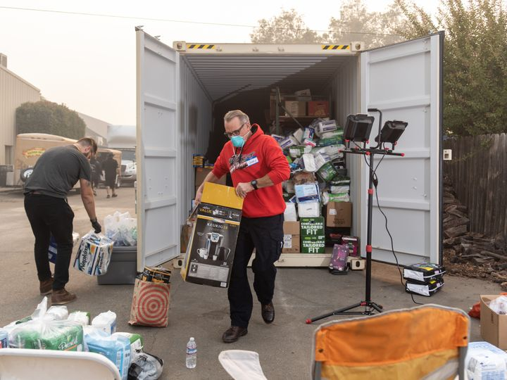Gary P., from Red Bluff, California, volunteers by sorting toiletry items at the East Ave Church shelter.