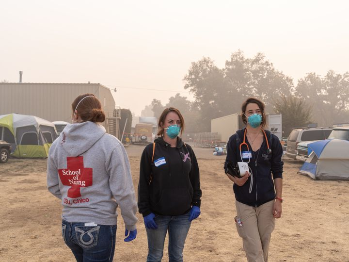 Sutter North RNs Jessica Garza and Maggie Page, along with UCSF RN Casey Domine, volunteer at the East Ave Community Church shelter, checking on victims of the Camp fire.