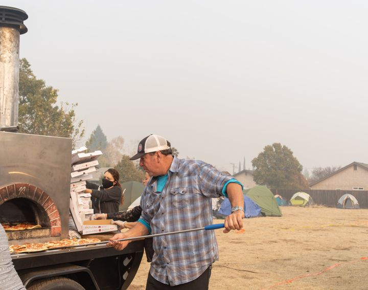 Jim King cooking pizzas for evacuees.