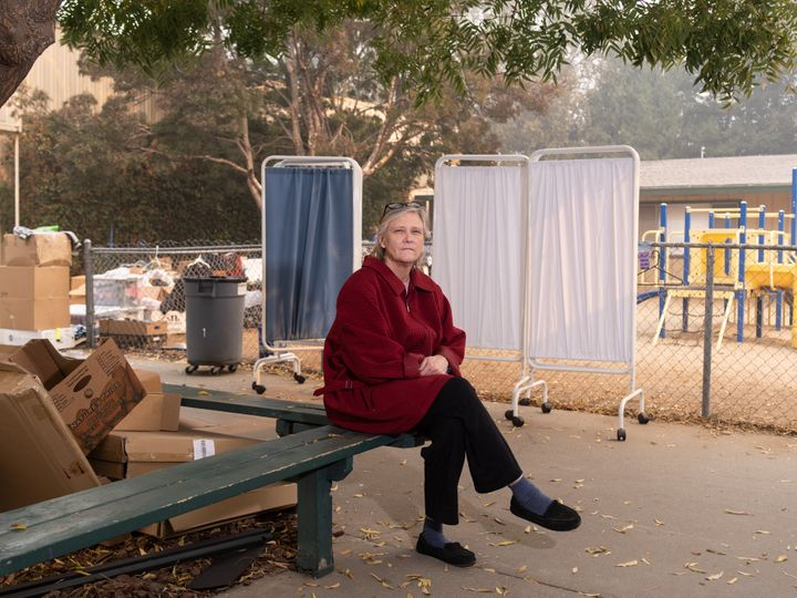 Libby Andresen outside of the shelter at East Ave Church. Andresen, her mother and brother were evacuated from their homes in Paradise, California.