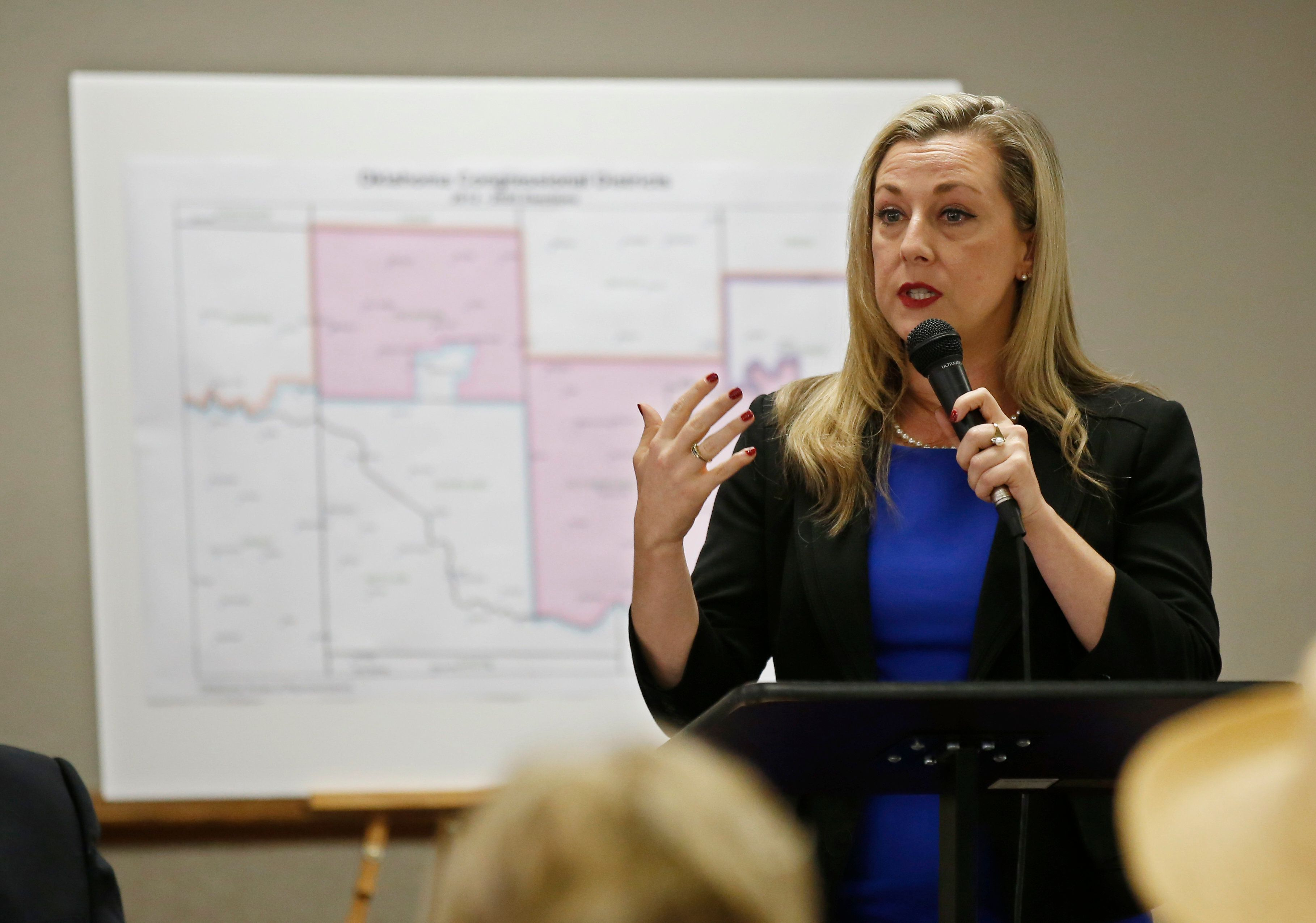FILE - In this May 10, 2018 file photo, Kendra Horn speaks during a forum for Oklahoma 5th congressional district seat Democratic candidates in Edmond, Okla. Horn is facing incumbent Republican Rep. Steve Russell. (AP Photo/Sue Ogrocki, File)