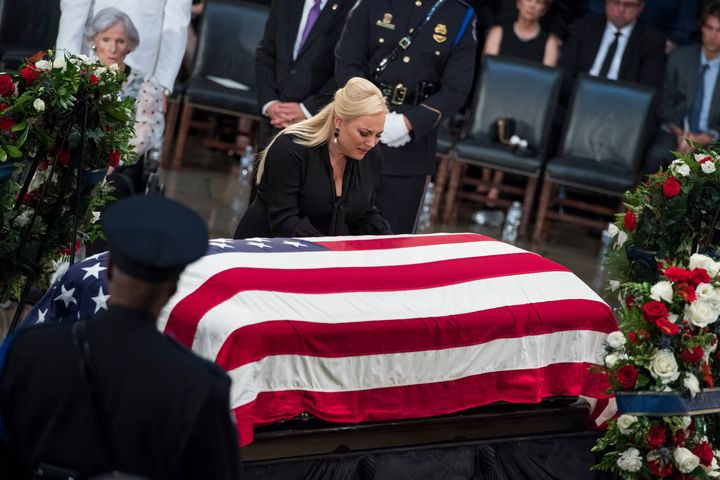 Meghan McCain knells at the coffin of her father, Sen. John McCain, R-Ariz., as he lays in state in the Capitol rot