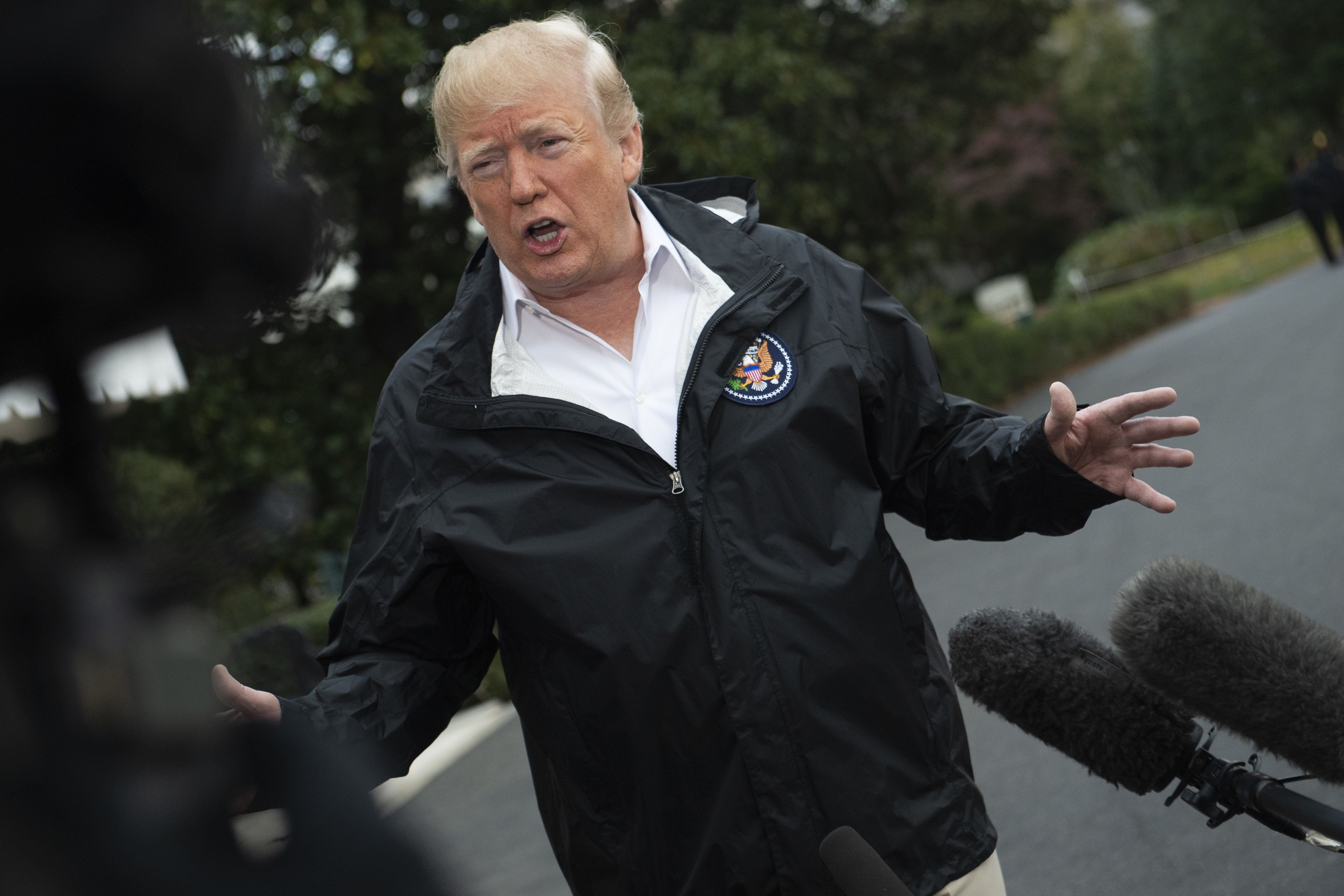 US President Donald Trump talks to the press as he leaves the White House in Washington, DC, for California to visit the Camp Fire disaster area on November 17, 2018. - President Donald Trump was to arrive on November 17 in California where more than 1,000 people are listed missing in the worst-ever wildfire to hit the wealthiest US state, which is at the forefront of resistance to Trump's environmental and other policies. The deadliest and most destructive wildfire in California's history, the so-called Camp Fire, has now claimed 71 lives after authorities found eight additional sets of human remains. (Photo by Eric BARADAT / AFP)        (Photo credit should read ERIC BARADAT/AFP/Getty Images)