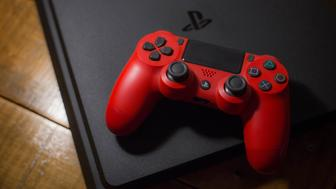 BANGKOK, THAILAND - 2018/05/24: A Sony PlayStation 4 video game console with a red wireless controller next to it. The PlayStation 4 or PS4 is knows as the eighth generation of home video game console developed by the Japanese company Sony Interactive Entertainment. The console sold for about 74 million units since it was released in November 2013. (Photo by Guillaume Payen/SOPA Images/LightRocket via Getty Images)