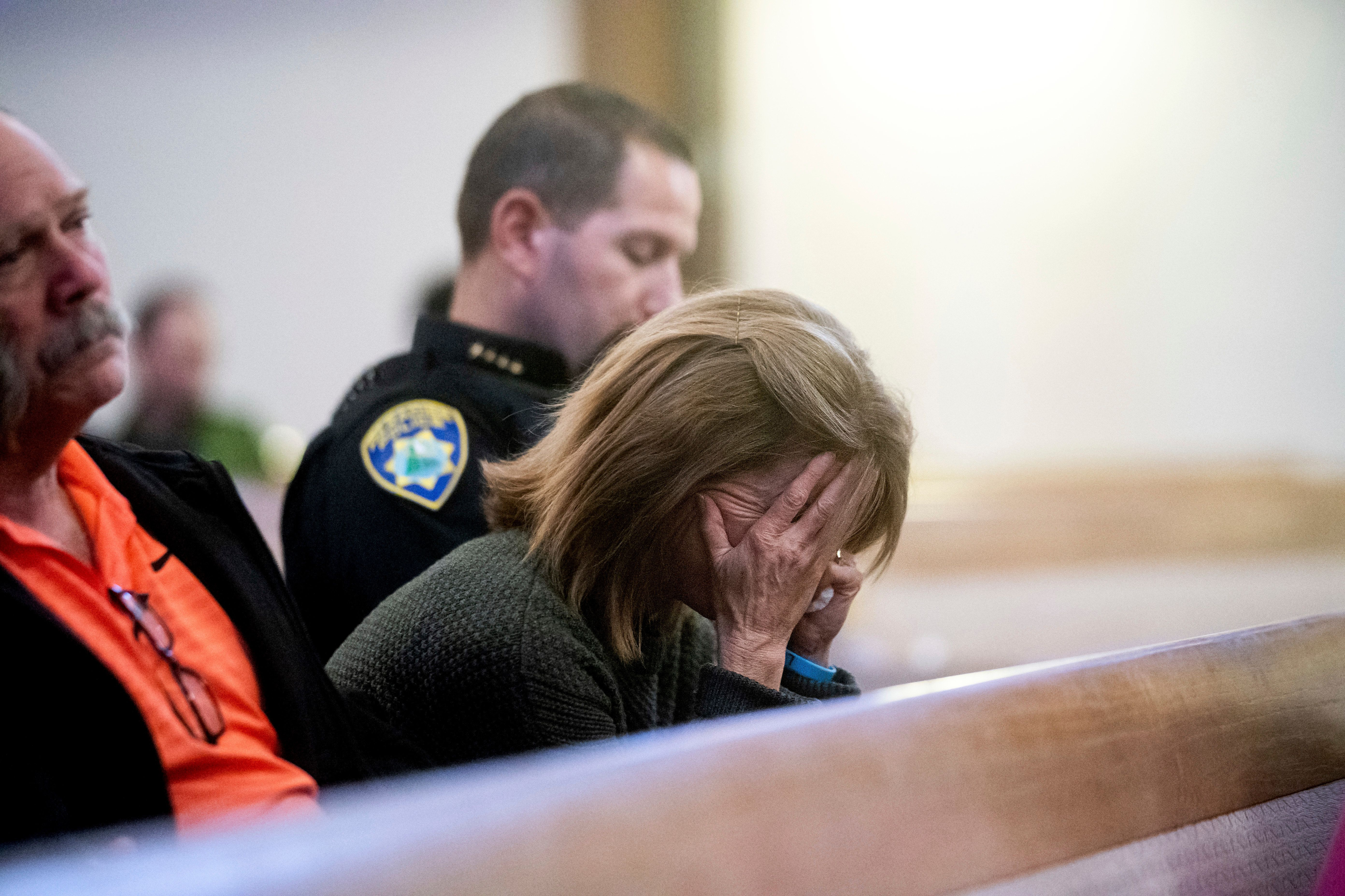 Lauren Gill,the town manager for Paradise, California, cries during a vigil for Camp Fire victims...