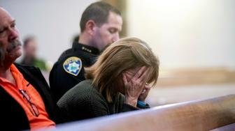 Paradise Town Manager Lauren Gill cries during a vigil for Camp Fire victims on Sunday, Nov. 18, 2018, at the First Christian Church of Chico in Chico, Calif. Mourners gathered at the memorial for the victims. People hugged and shed tears as Pastor Jesse Kearns recited a prayer for first responders. (AP Photo/Noah Berger, Pool)