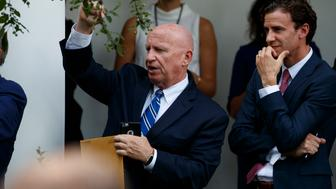 House Ways and Means Committee chairman Rep. Kevin Brady, R-Texas, cheers as President Donald Trump and European Commission president Jean-Claude Juncker speak on trade in the Rose Garden of the White House, Wednesday, July 25, 2018, in Washington. (AP Photo/Evan Vucci)