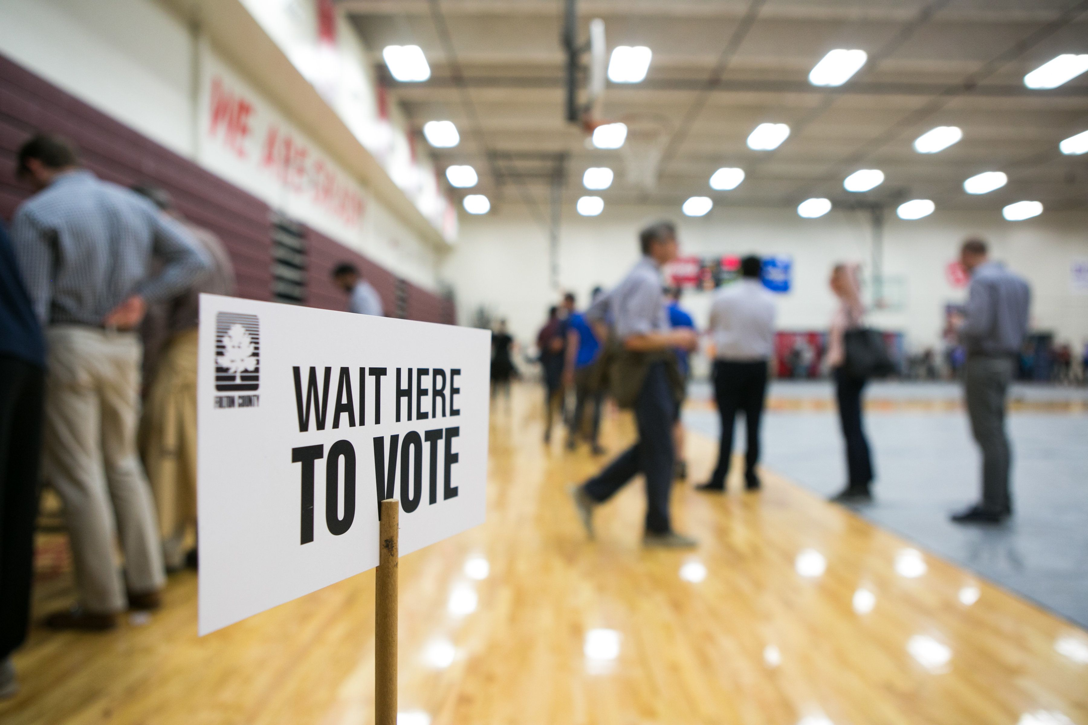 ATLANTA, GA - NOVEMBER 06: Voters line up to cast their ballots at a polling station set up at Grady High School for the mid-term elections on November 6, 2018 in Atlanta, Georgia.  Georgia has a tight race to elect the state's next Governor.  (Photo by Jessica McGowan/Getty Images)