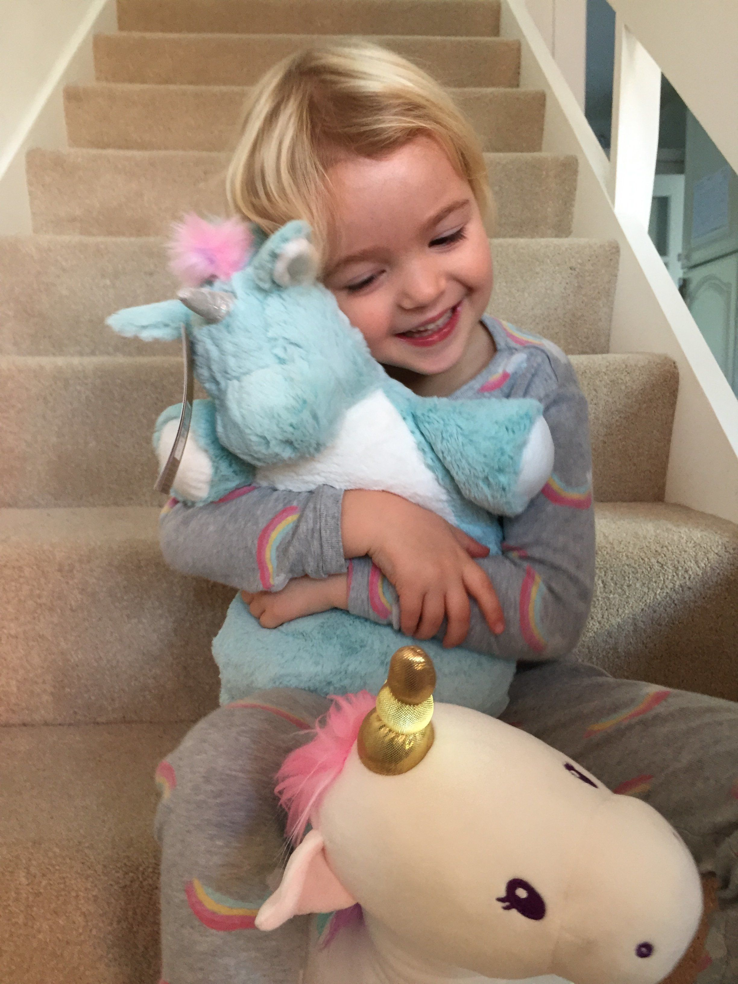 Margo hugs her favourite unicorn