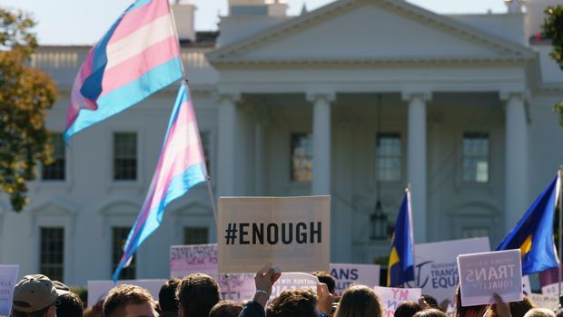 """The National Center for Transgender Equality, NCTE, and the Human Rights Campaign gather on Pennsylvania Avenue in front of the White House in Washington, Monday, Oct. 22, 2018, for a #WontBeErased rally. Anatomy at birth may prompt a check in the """"male"""" or """"female"""" box on the birth certificate _ but to doctors and scientists, sex and gender aren't always the same thing. The Trump administration purportedly is considering defining gender as determined by sex organs at birth, which if adopted could deny certain civil rights protections to an estimated 1.4 million transgender Americans. (AP Photo/Carolyn Kaster)"""
