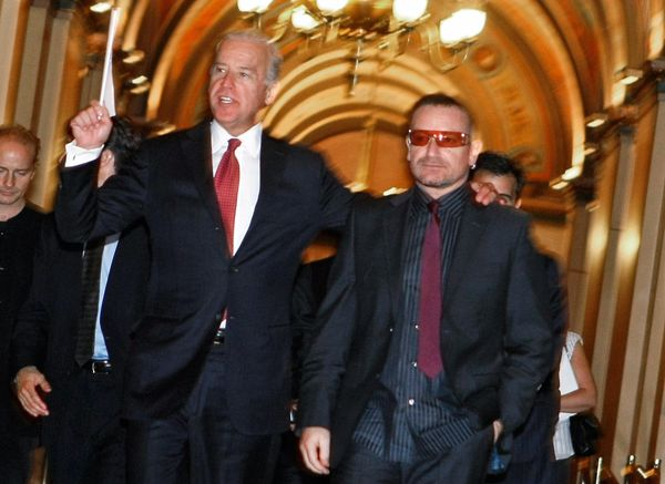 U2 frontman Bono walks with Biden to a meeting with lawmakers on Capitol Hill in Washington on Oct. 3, 2007.