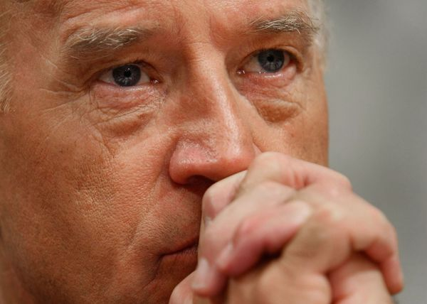 Biden, the chairman of the Senate Foreign Relations Committee, listens to opening remarks from General David Petraeus on Capi