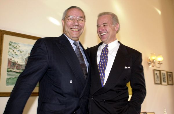 Gen. Colin Powell and Biden share a light moment during a photo op before aquestion-and-answer session with the press o