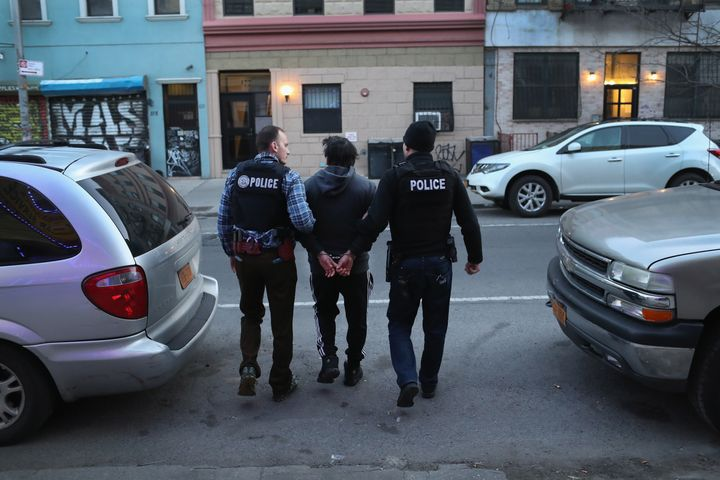 ICE officers arrest a man during a raid in Brooklyn, New York.
