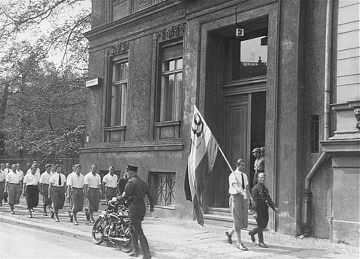 Students organized by the Nazi party parade in front of the building of the Institute for Sexual Research in Berlin prior to