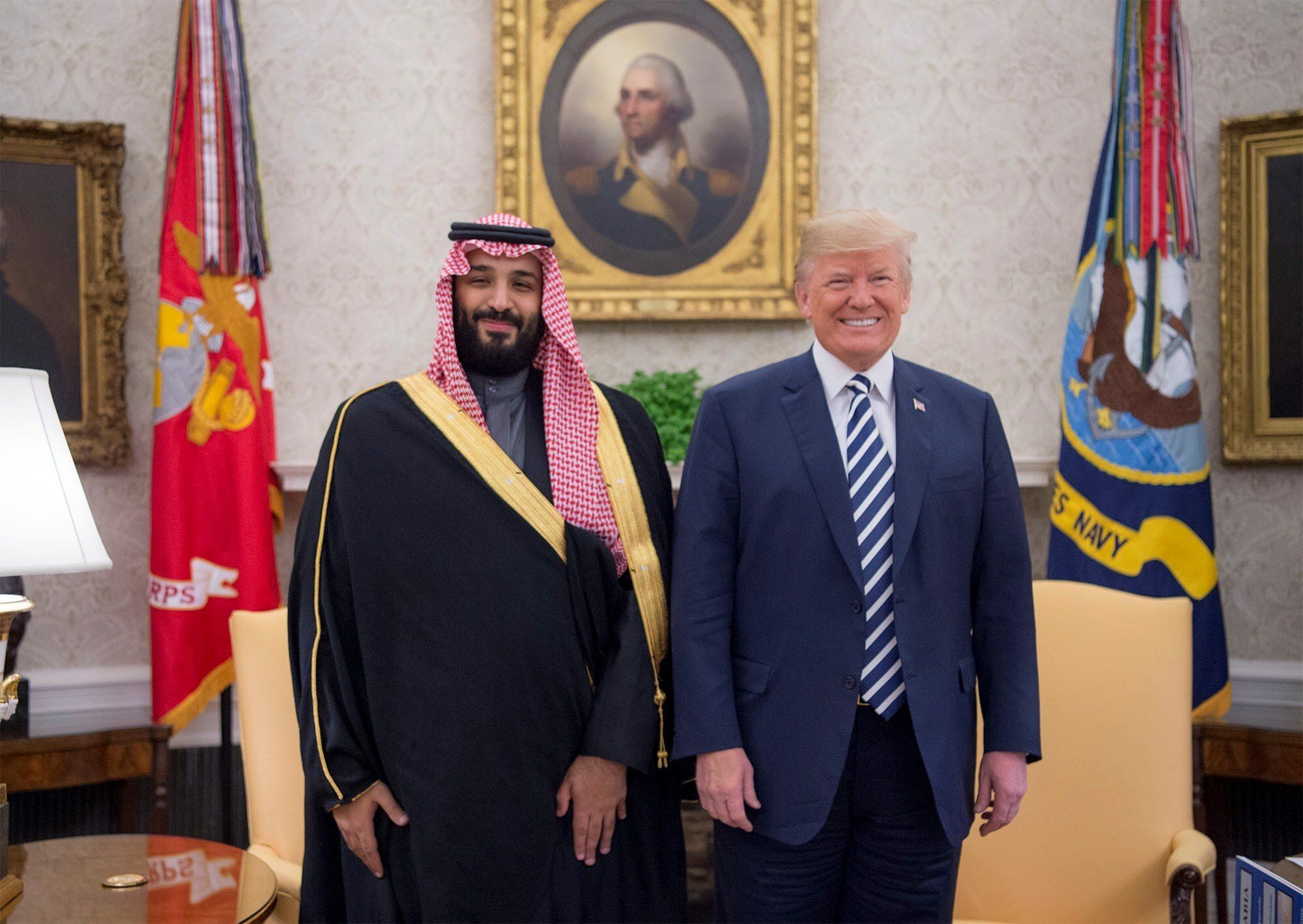 WASHINGTON, USA - MARCH 20: (----EDITORIAL USE ONLY  MANDATORY CREDIT - 'BANDAR ALGALOUD / SAUDI KINGDOM COUNCIL / HANDOUT' - NO MARKETING NO ADVERTISING CAMPAIGNS - DISTRIBUTED AS A SERVICE TO CLIENTS----) U.S. President Donald Trump (R) poses for a photo with Crown Prince Mohammed bin Salman Al Saud (L) of Saudi Arabia in the Oval Office at the White House on March 20, 2018 in Washington, United States. (Photo by Bandar Algaloud / Saudi Kingdom Council / Handout/Anadolu Agency/Getty Images)