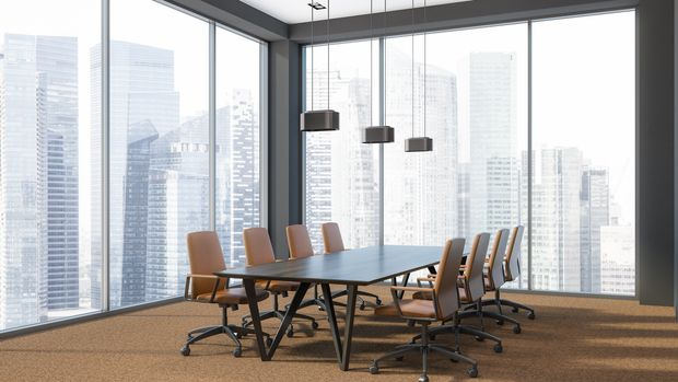 Modern office conference room corner with panoramic windows, a brown carpet and a long wooden table with leather armchairs. Consulting and board concept. 3d rendering copy space