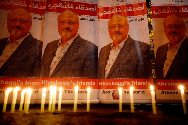 Candles, lit by activists protesting the killing of Saudi journalist Jamal Khashoggi, are placed outside...