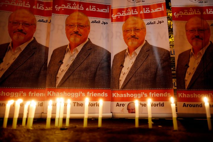 Candles, lit by activists protesting the killing of Saudi journalist Jamal Khashoggi, are placed outside Saudi Arabia's consu