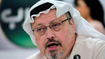 FILE - In this Dec. 15, 2014, file photo, Saudi journalist Jamal Khashoggi speaks during a press conference in Manama, Bahrain. A pro-government Turkish newspaper on Wednesday, Oct. 17, 2018 published a gruesome recounting of the alleged slaying of Saudi writer Jamal Khashoggi at the Saudi Consulate in Istanbul, just as America's top diplomat arrived in the country for talks over the Washington Post columnist's disappearance. (AP Photo/Hasan Jamali, File)