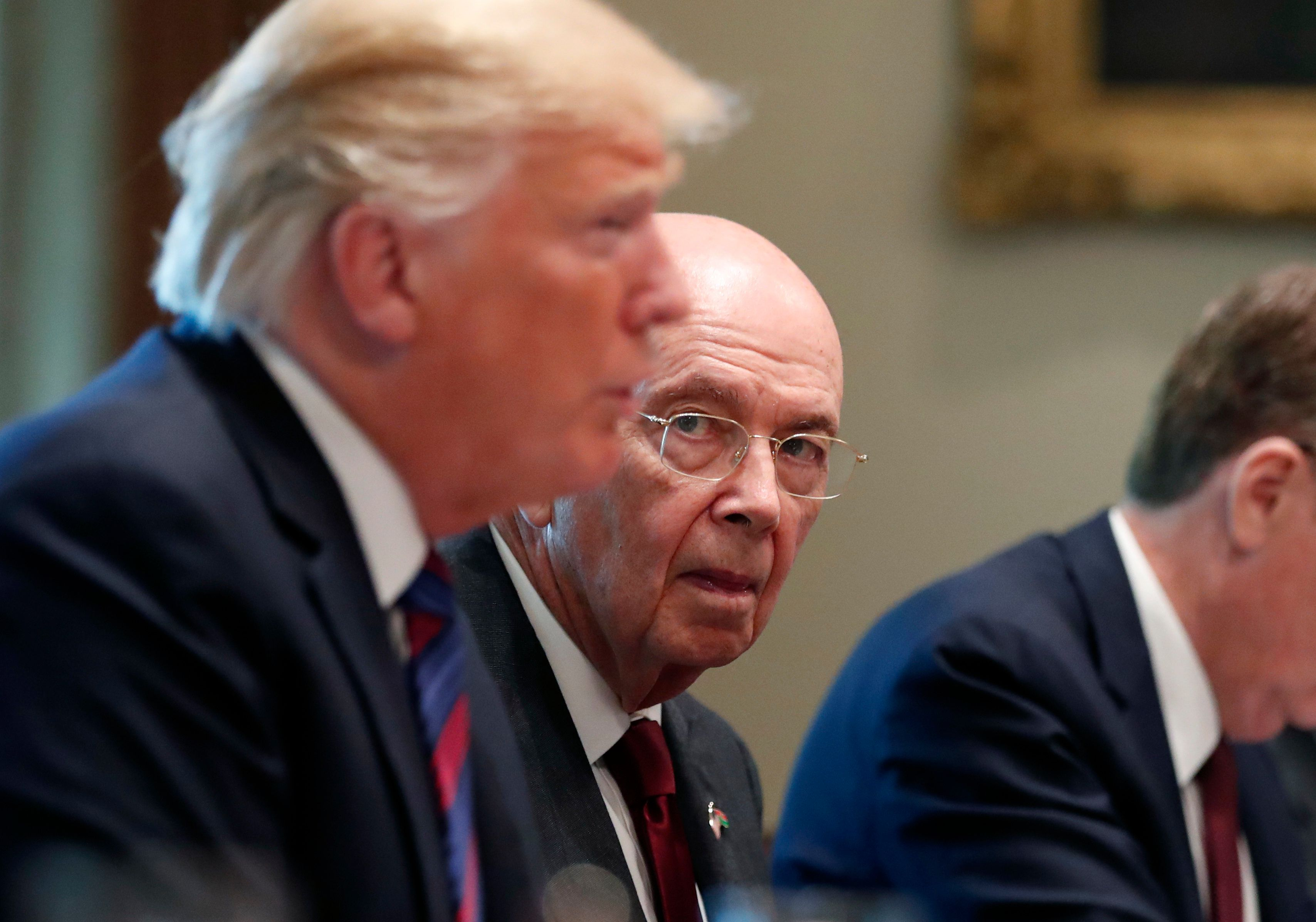 Commerce Secretary Wilbur Ross, right, listens as President Donald Trump speaks with Kenyan President Uhuru Kenyatta before a bilateral meeting in the Cabinet Room at the White House, Monday, Aug. 27, 2018, in Washington. (AP Photo/Alex Brandon)