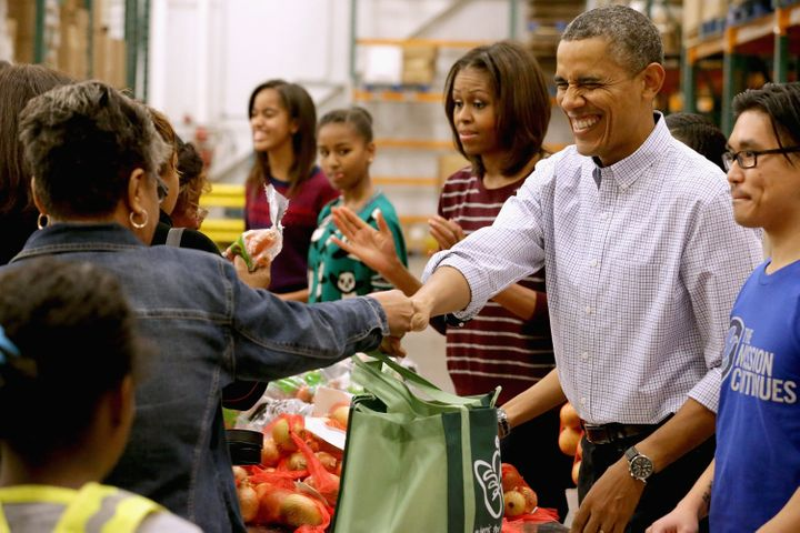 The Obamas packed and distributed bags of food at the Capital Area Food Bank in Washington, DC, in 2013.