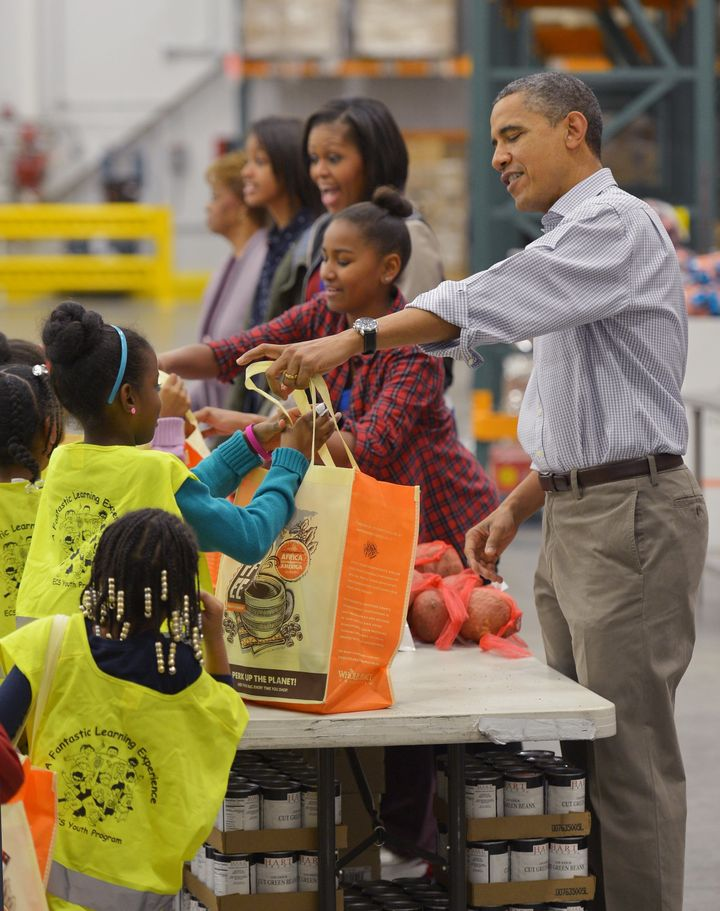 The Obamas distributed food at the Capitol Area Food Bank in Washington, DC, in 2012.