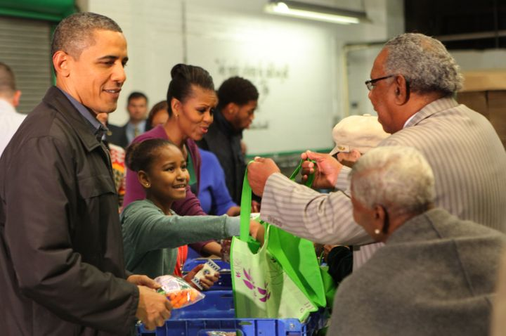 The Obamas handed out food packages at the Capital Area Food Bank in 2011.