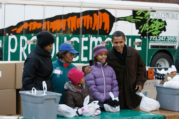 As president-elect in 2008, Obama and his family gave away care packages at a food bank in Chicago.