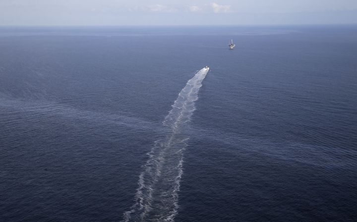 An oil sheen from the site of the former Taylor Energy oil rig is seen in the wake of a supply vessel off the coast of Louisi