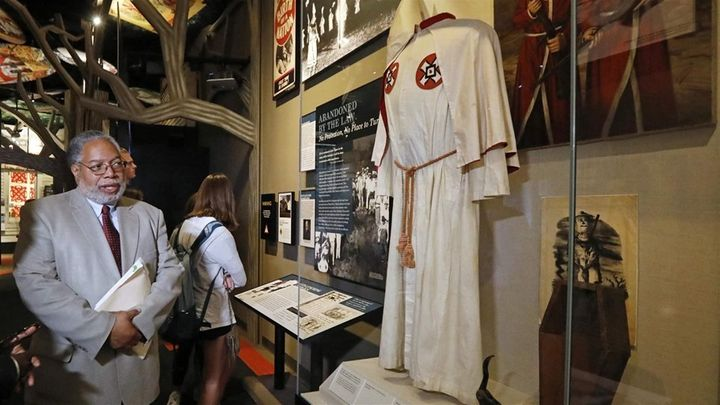 Lonnie Bunch, founding director of the National Museum of African American History and Culture, looks at a Ku Klux Klan displ