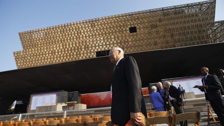 Former Secretary of State Colin Powell arrives for the dedication of the National Museum of African American History and Cult