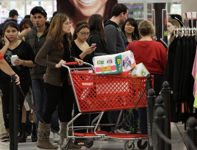 A crowd of shoppers browses the Black Friday sales at a Target in Burbank, California, in