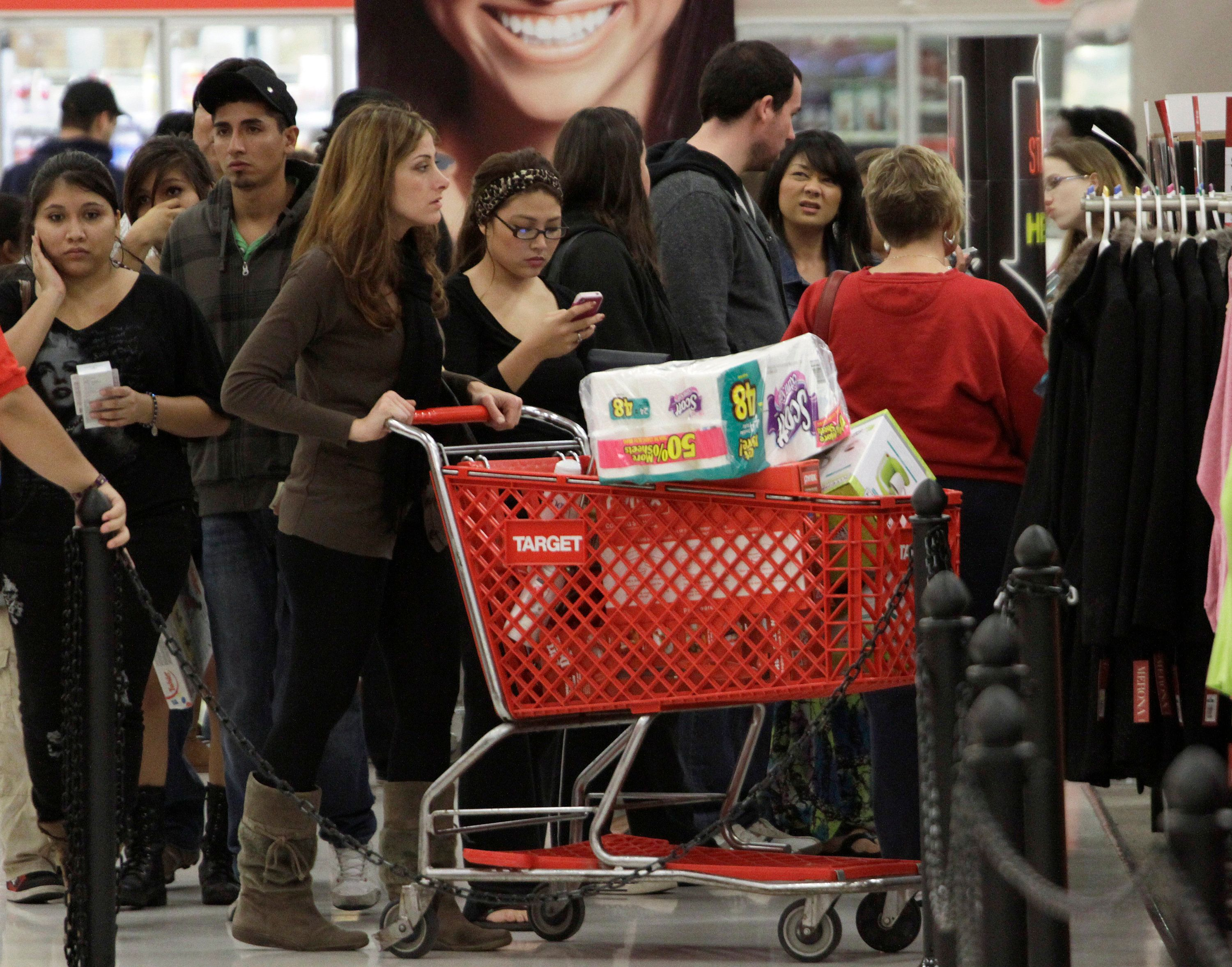 "A crowd of shoppers browse at Target on Thanksgiving Day in Burbank, California November 22, 2012. The shopping frenzy known as ""Black Friday"" kicked off at a more civilized hour welcomed by some shoppers this year, with retailers like Target Corp and Toys R Us moving their openings earlier into Thursday night. Picture taken November 22, 2012.     REUTERS/Jonathan Alcorn (UNITED STATES - Tags: BUSINESS)"