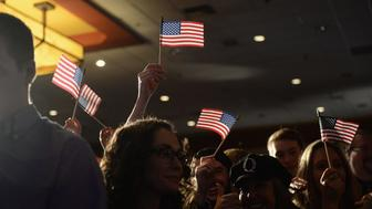 SPRINGFIELD, MO - NOVEMBER 06: Supporters waive American Flags during the Josh Hawley Election Night watch party at the University Plaza Hotel and Conference Center on November 6, 2018 in Springfield, Missouri. Josh Hawley defeated incumbent Senator Claire McCaskill.(Photo by Michael B. Thomas/Getty Images)