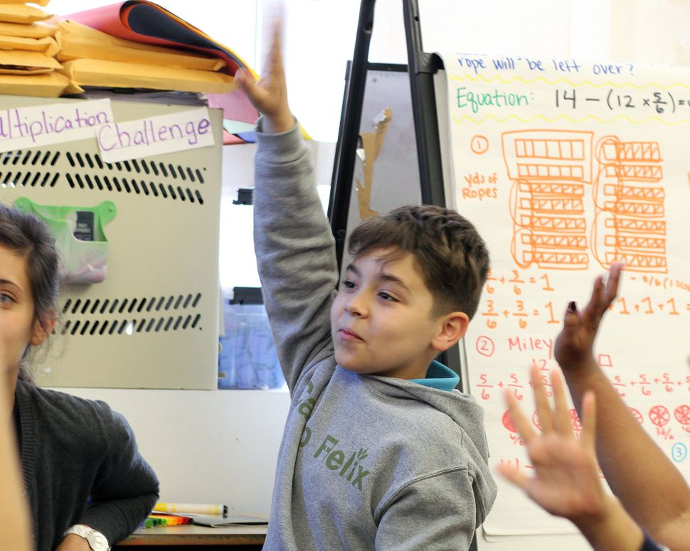 Brandon in his fourth-grade classroom at Mott Haven Academy Charter School. Brandon enrolled in the school as a kindergartner