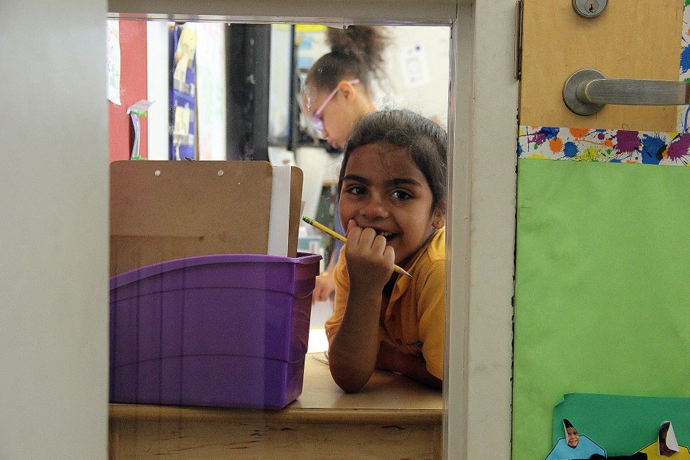 Alyssa in her first-grade classroom at Mott Haven Academy Charter School, where she enrolled after moving in with a foster mo