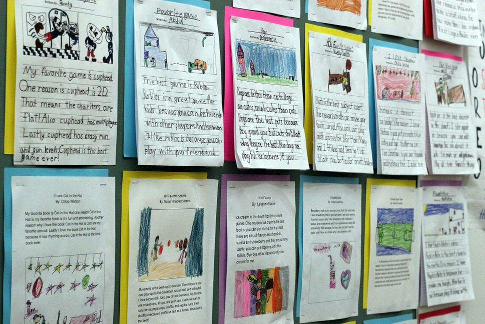 he classroom walls of Mott Haven Academy Charter School are covered in student work.