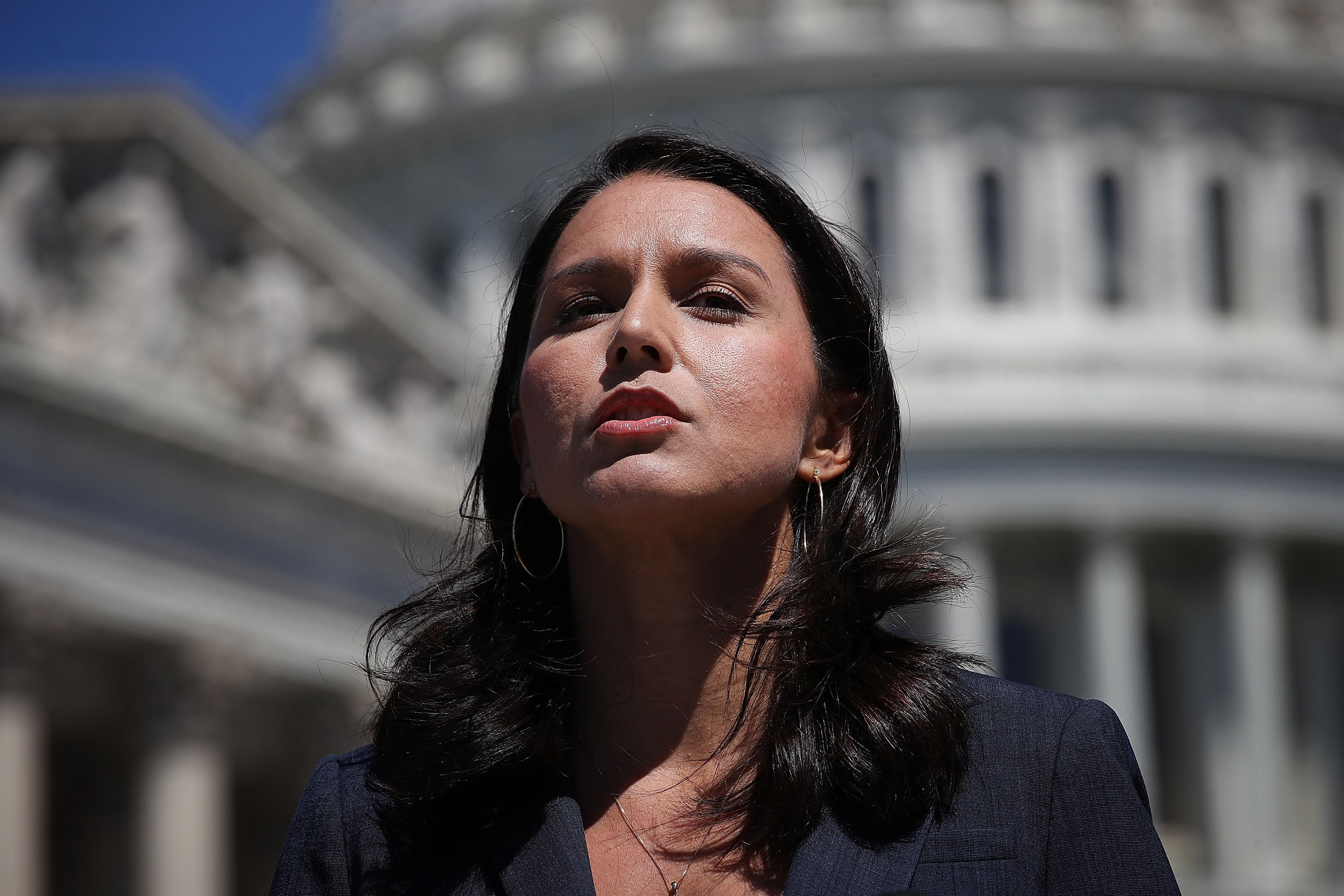 WASHINGTON, DC - JULY 18:  Rep. Tulsi Gabbard (D-HI) speaks at a press conference on House Resolution 922 outside the U.S. Capitol July 18, 2018 in Washington, DC. Gabbard and Rep. Walter Jones (R-NC) spoke on reclaiming 'Congress's constitutional right to declare war' and efforts to define presidential wars not declared by Congress as impeachable 'high crimes and misdemeanors.'  (Photo by Win McNamee/Getty Images)