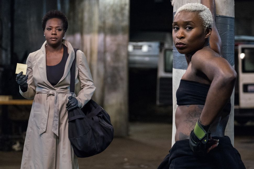"Adapted from a 1983 British miniseries, ""Widows"" is a whole lot of movie: a heist thriller, a screed about politi"