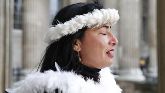 Tarita Alarcon Rapu, Governor of Easter Island gives a press conference outside the British Museum in London after requesting the return of Hoa Hakananai'a, an ancestor figure 'moai' from the museum on November 20, 2018. (Photo by Adrian DENNIS / AFP)        (Photo credit should read ADRIAN DENNIS/AFP/Getty Images)
