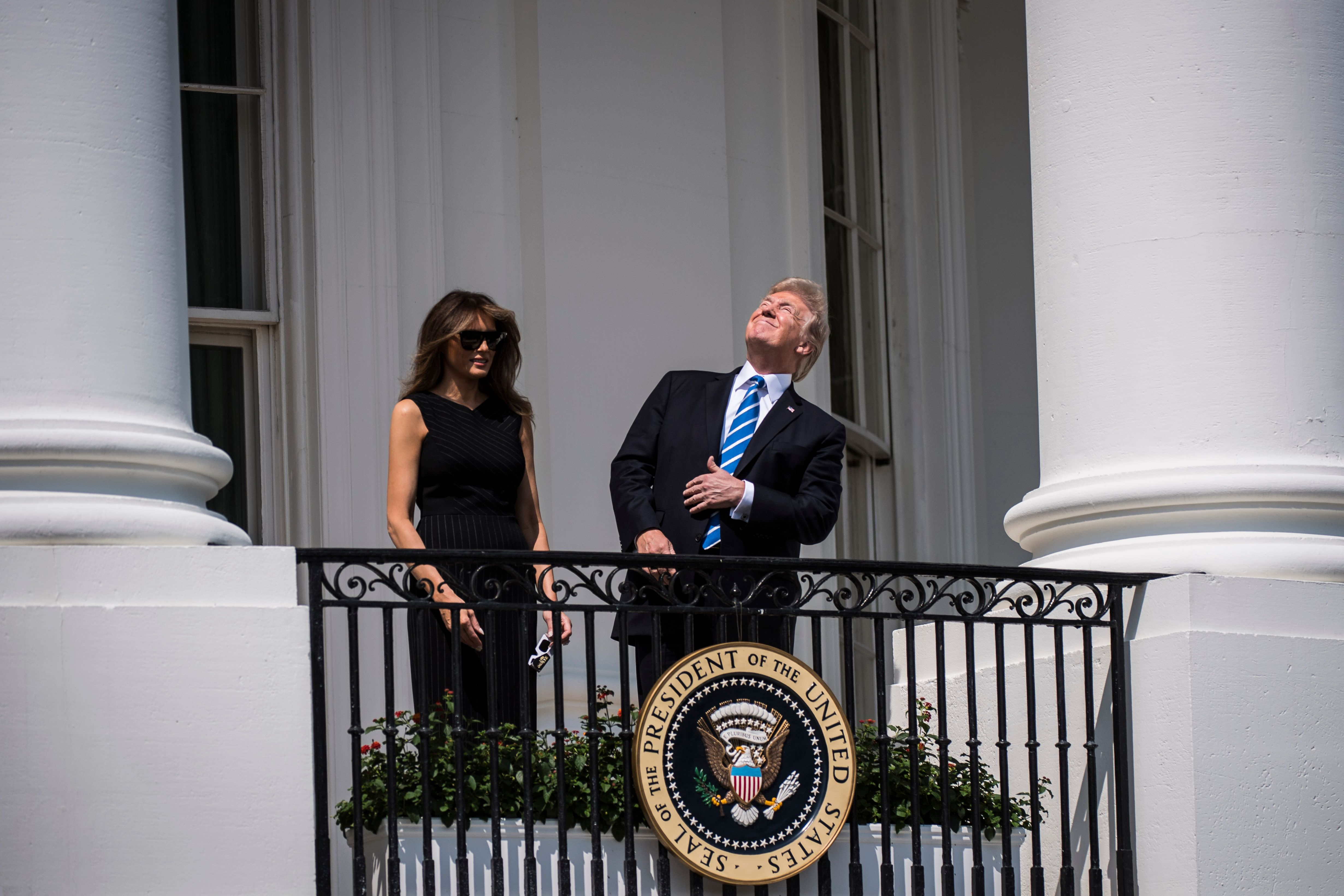 WASHINGTON, DC - AUGUST 21: President Donald Trump looks up toward the Solar Eclipse without glasses from a balcony at the White House in Washington, DC on Monday, Aug 21, 2017. (Photo by Jabin Botsford/The Washington Post via Getty Images)