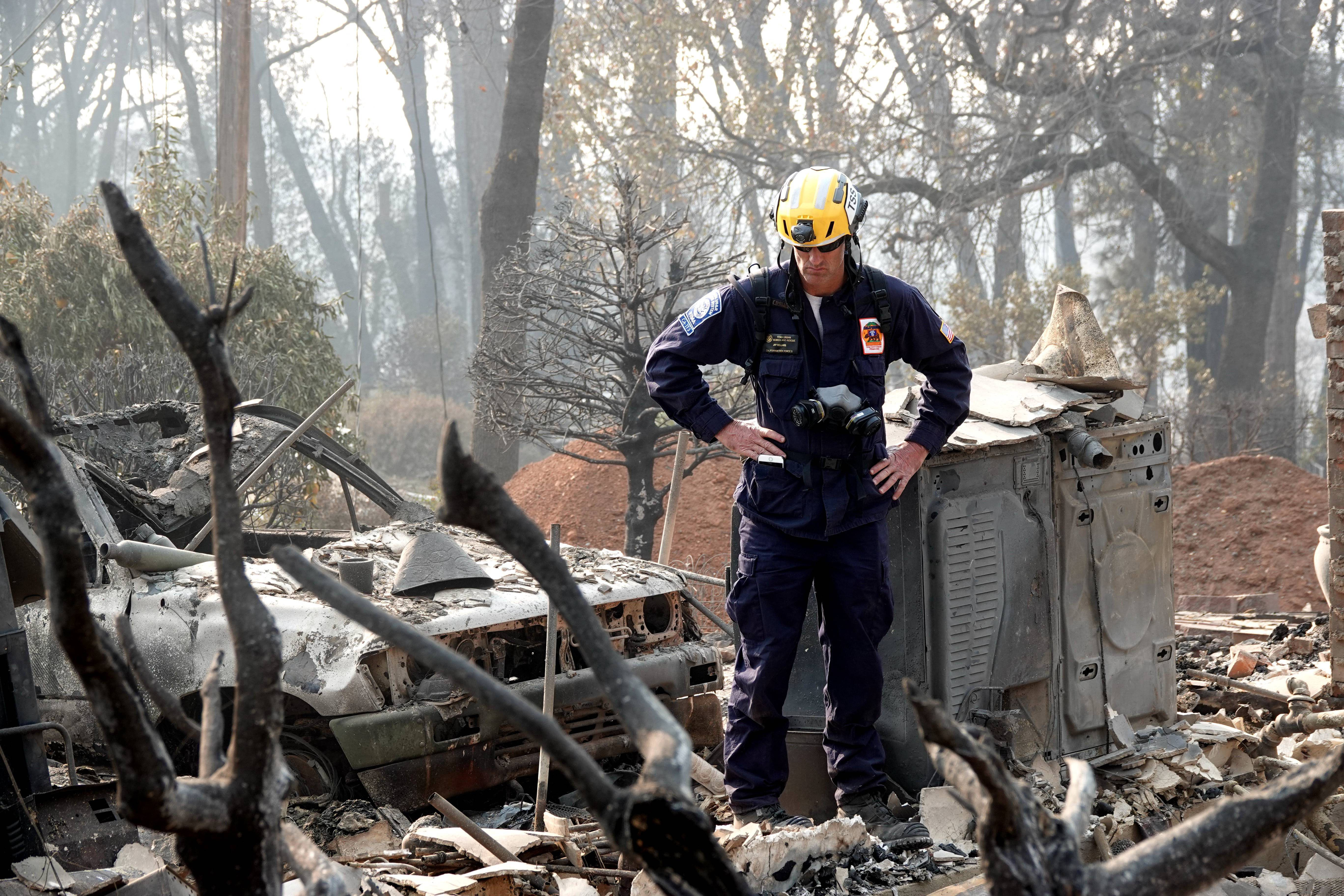 Rescue teams continue to search debris in Paradise, California, in the wake of the Camp fire's devastation.