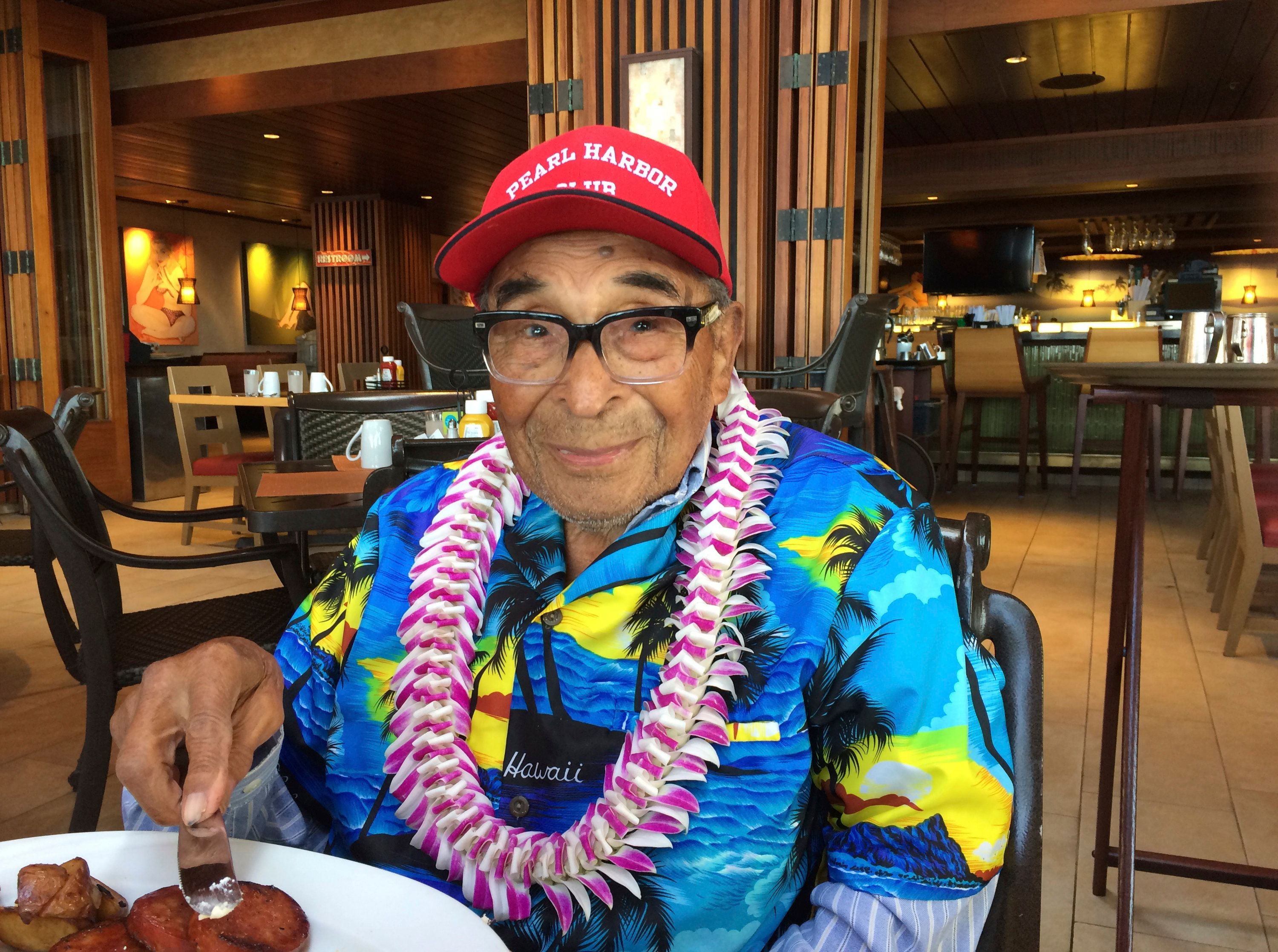 Pearl Harbor survivor Ray Chavez poses for a photo while eating breakfast in Honolulu. (Audrey McAvoy/AP)